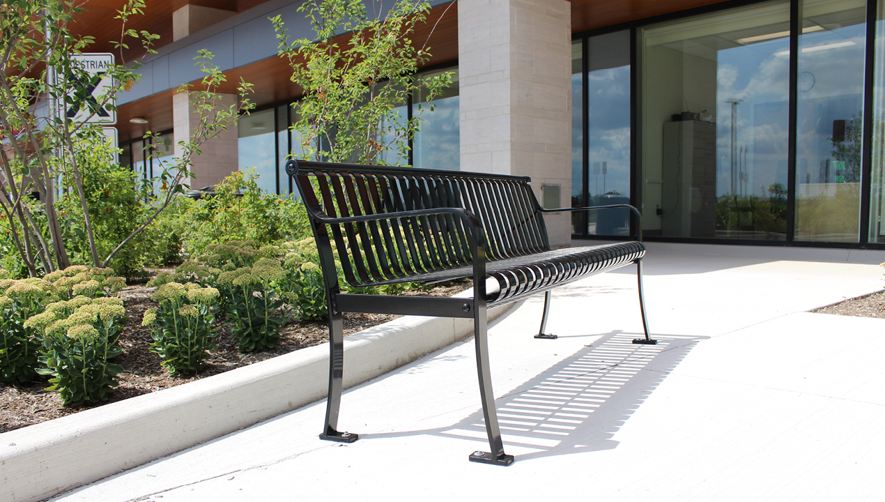 Metal bench with vertical slats outside