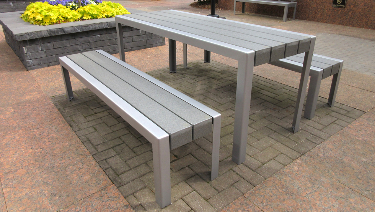 Table and Benches Outside on Concrete Area