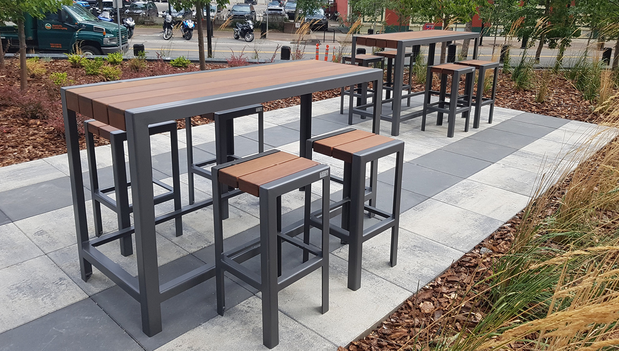 Bar height 1050 tables and backless stools