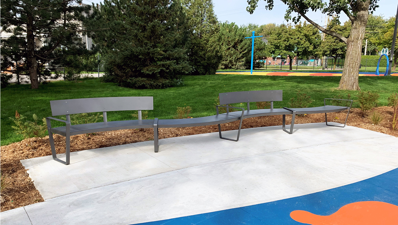 Curvy Lexicon Benches with and without backs in park setting