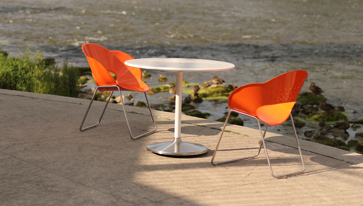 Orange Battery Chairs overlooking a river