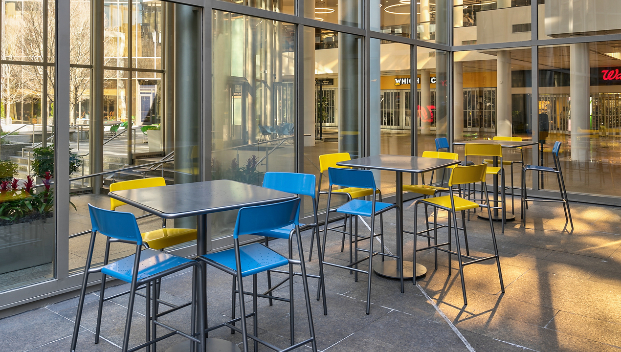 Yellow and Blue Chairs at tall square tables