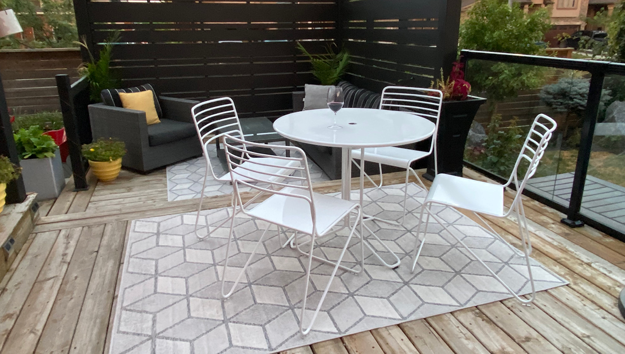 Kontour Collection of Cafe Table and Chairs in White on Patio