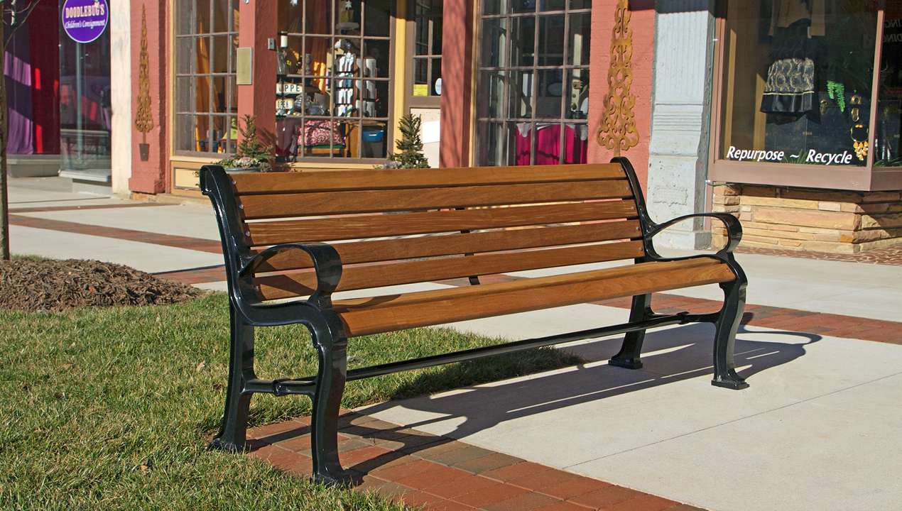 Wood and Metal Backed Bench Near Commercial Shops