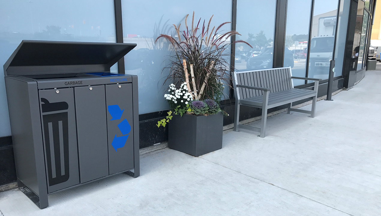 Garbage Unit, Planter and Backed Bench with Arms outside Building