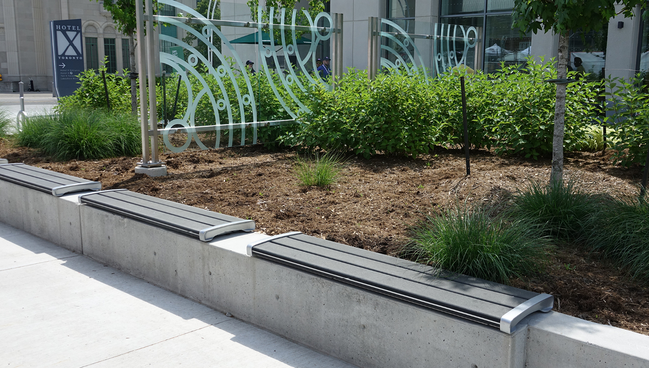 Mounted Backless Benches near shrubs