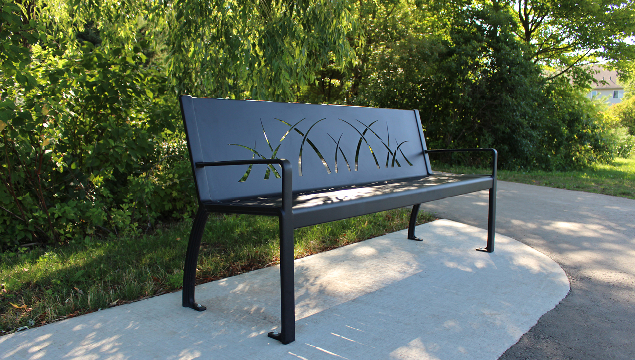 970 Bench with grass pattern sitting in park