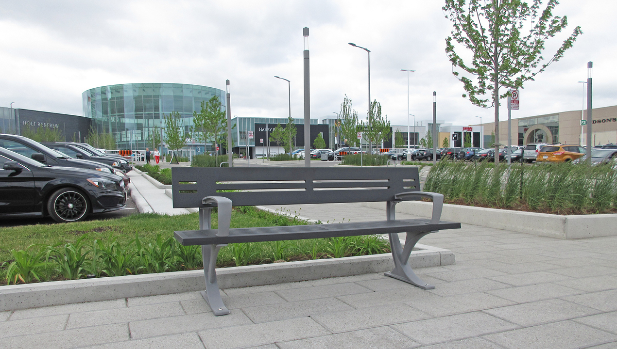 Silver Backed Bench with Arms near Commercial Area