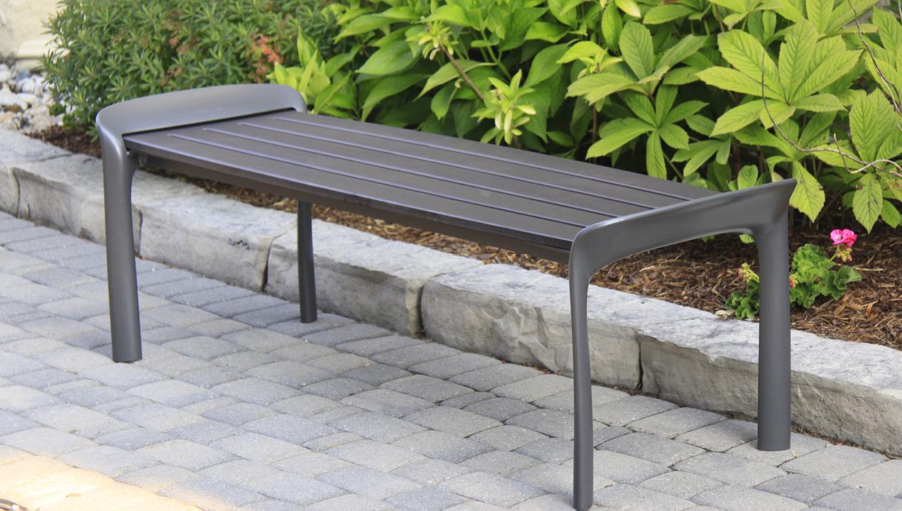 Grey Backless Bench near Gardens