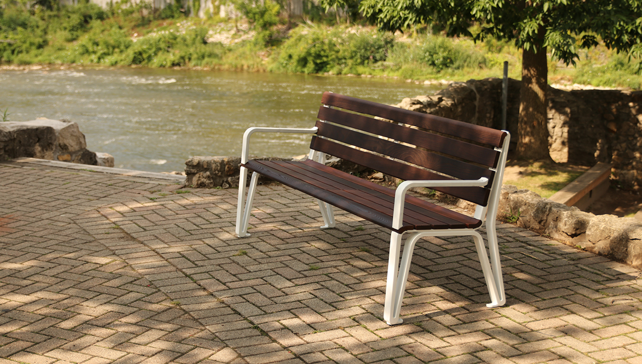 Backed Bench with Arms Near the River