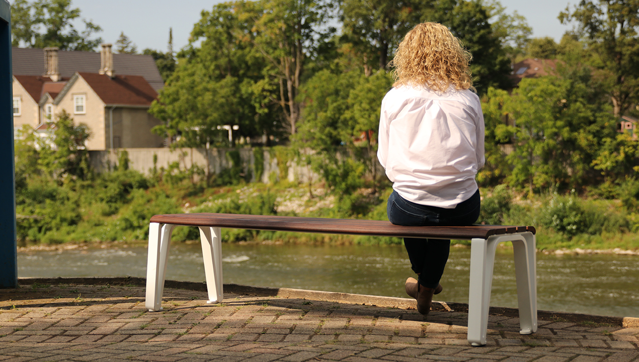 Woman on bench looking at River