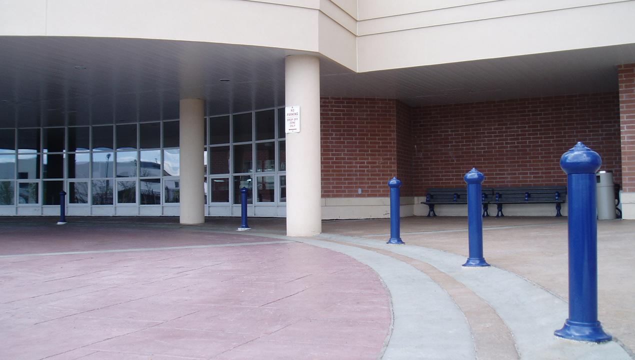Blue Bollards outside building