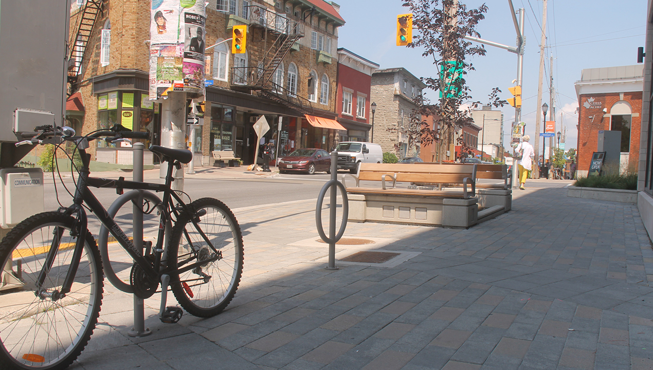 Silver Bike Racks with surface mounts on Downtown Streets