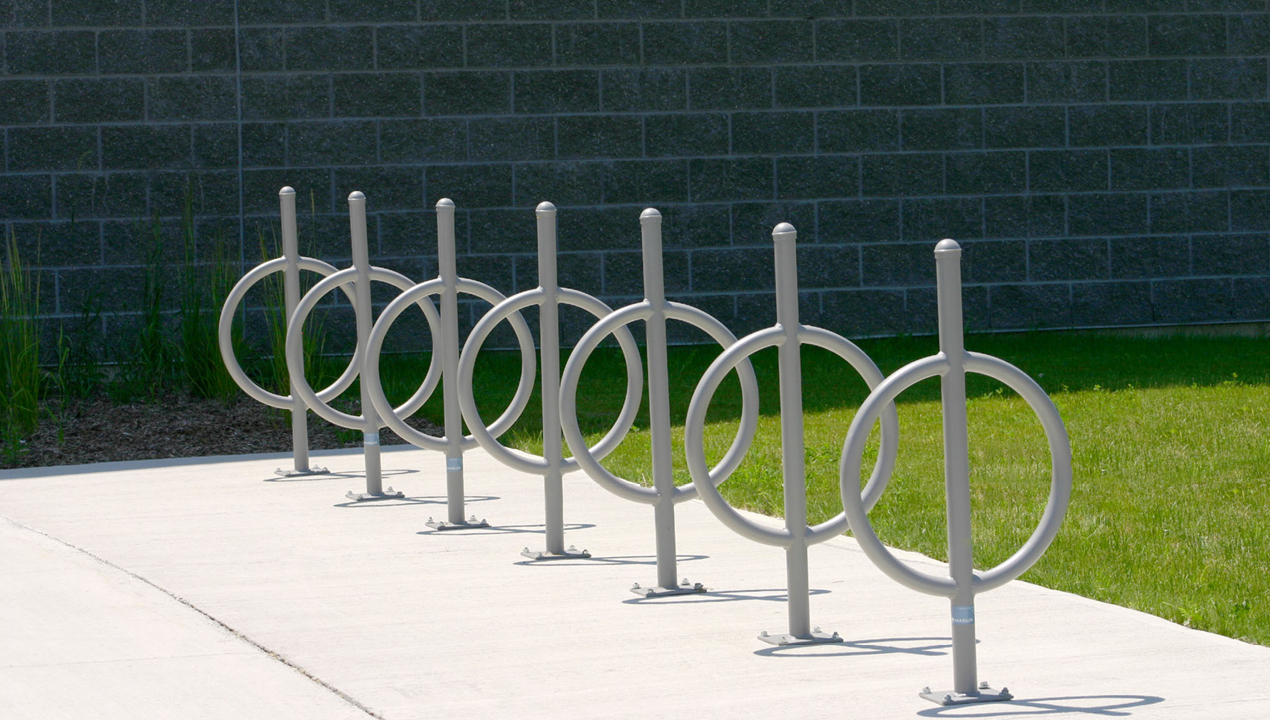 Seven Silver Bike Racks with Surface Mounts