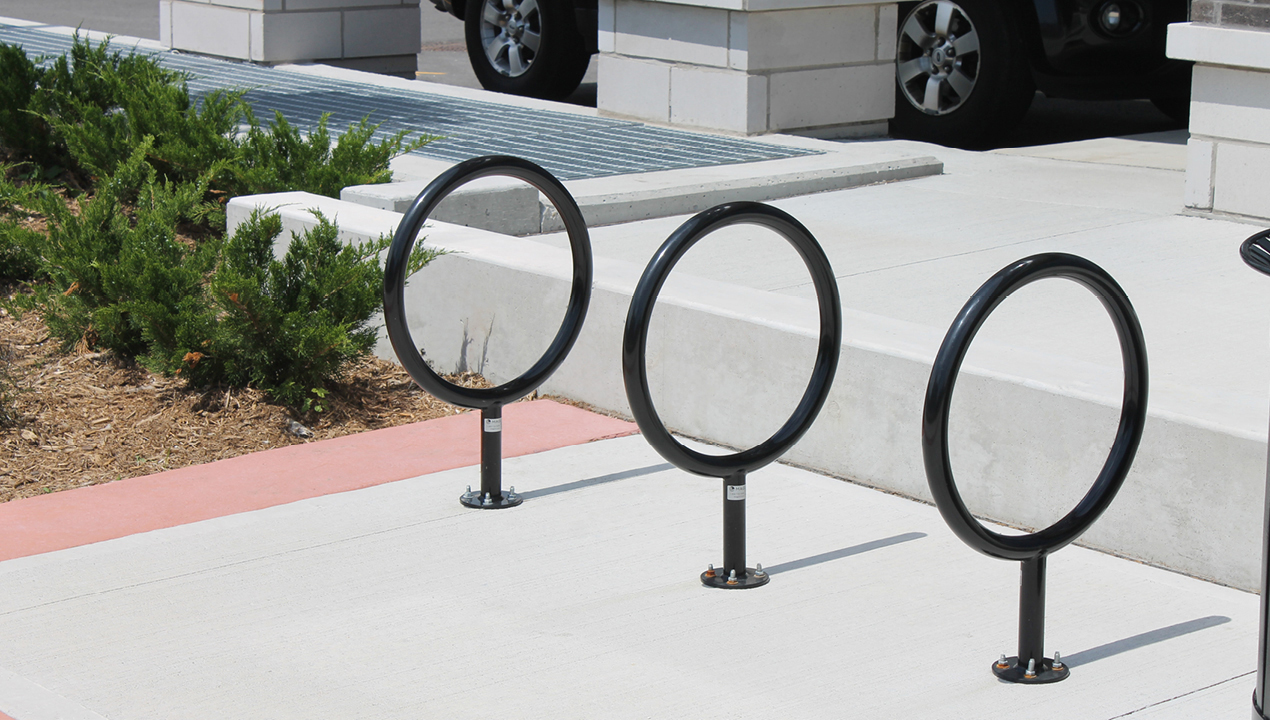 Three black circle bike racks
