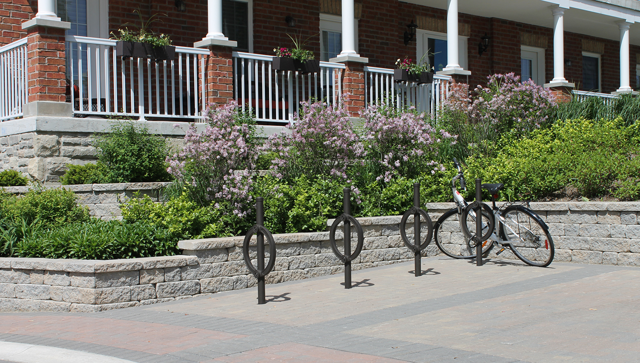 Black Direct Burial Bike Rack outside of Residential Area