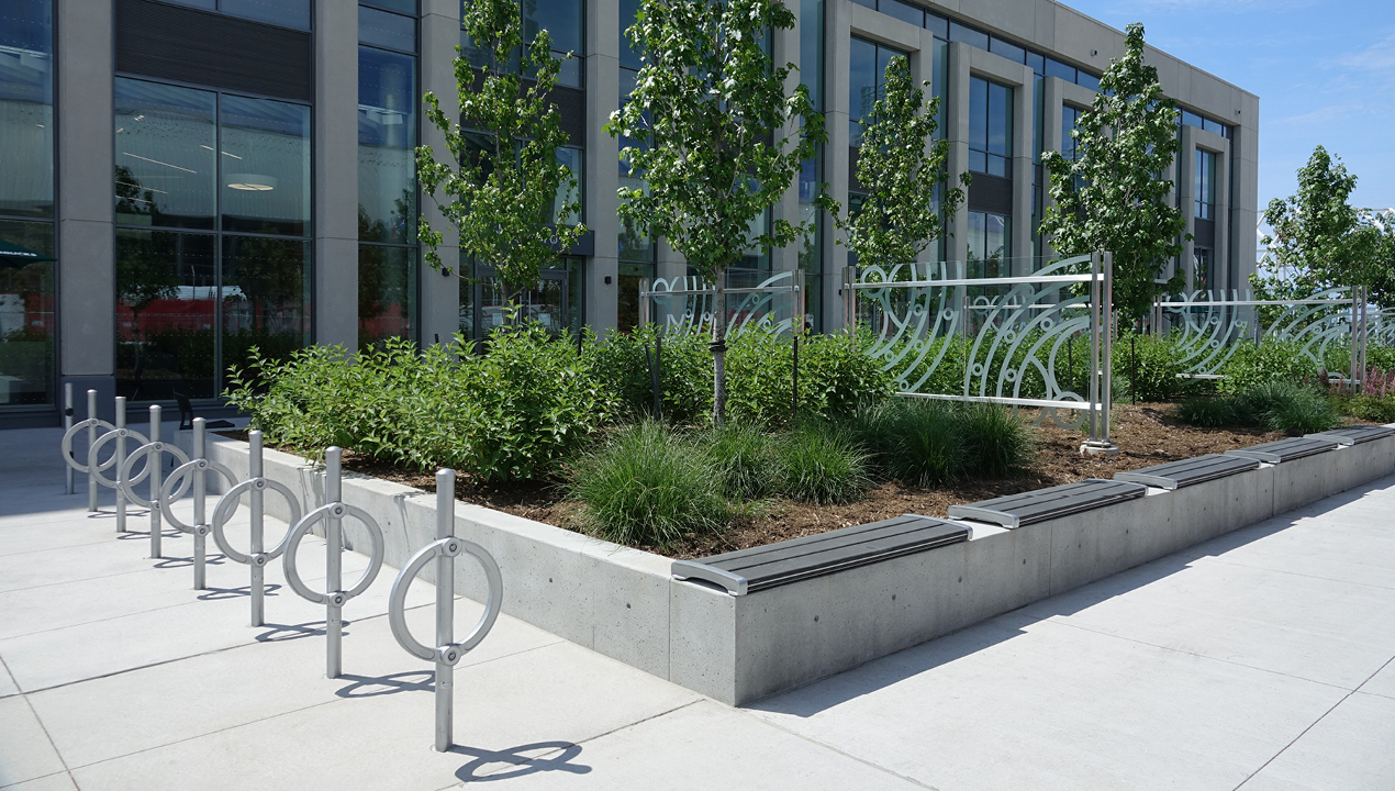 Silver Bike Racks with direct burials outside of building