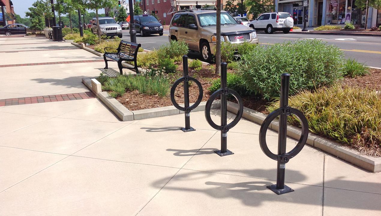 Three surface mount bike racks in black