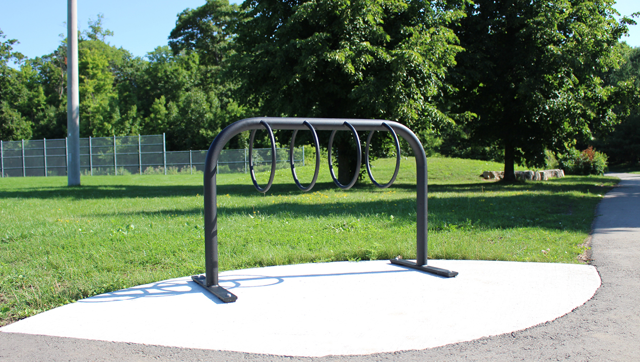 300 Style Bike Rack in park with sun shining and trees