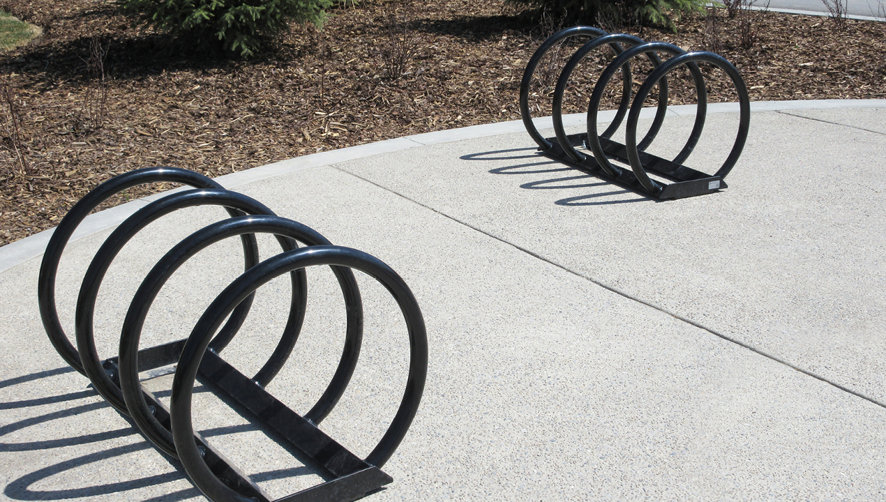 Two Black Bike Racks with four loops for attachment on each rack
