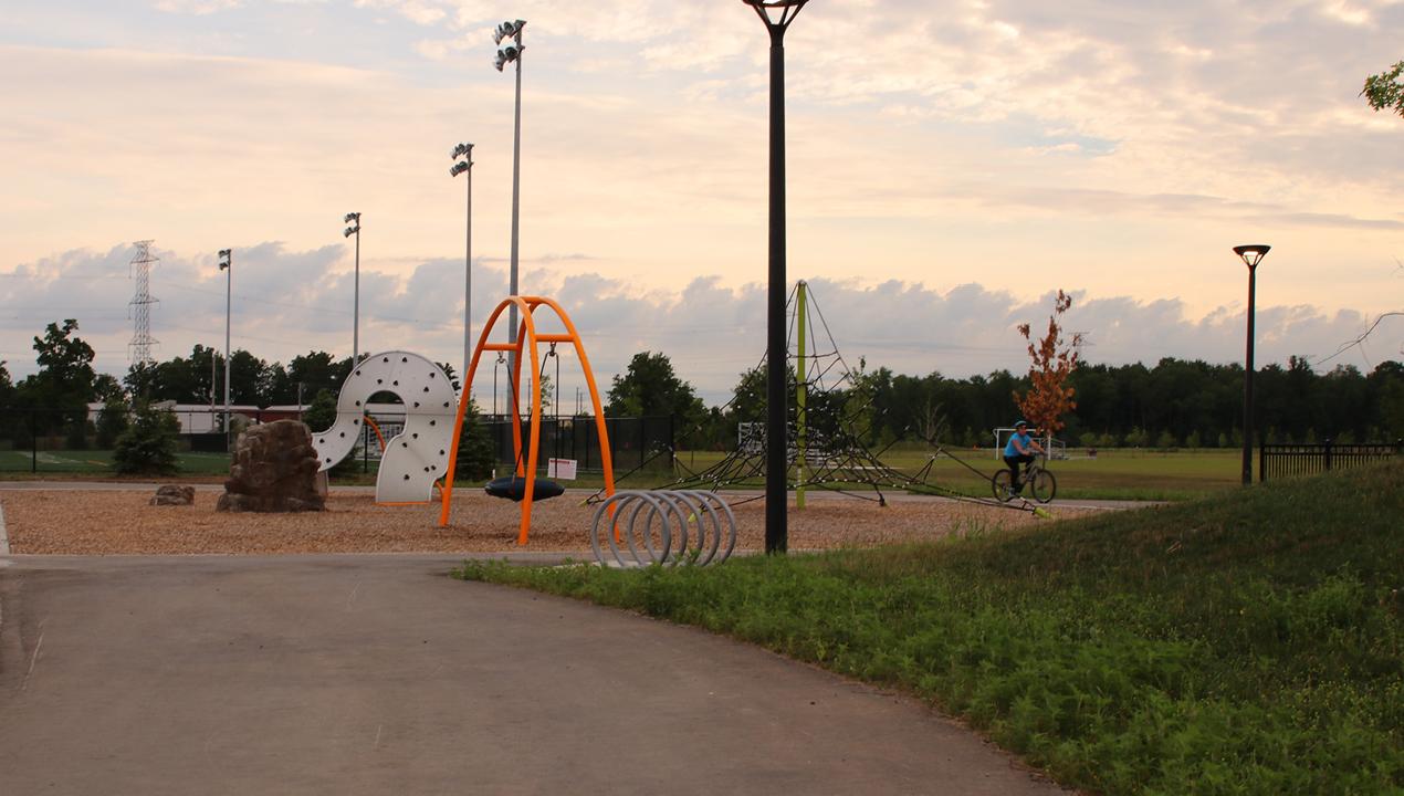 Silver Loop Bike Racks at a children's playground