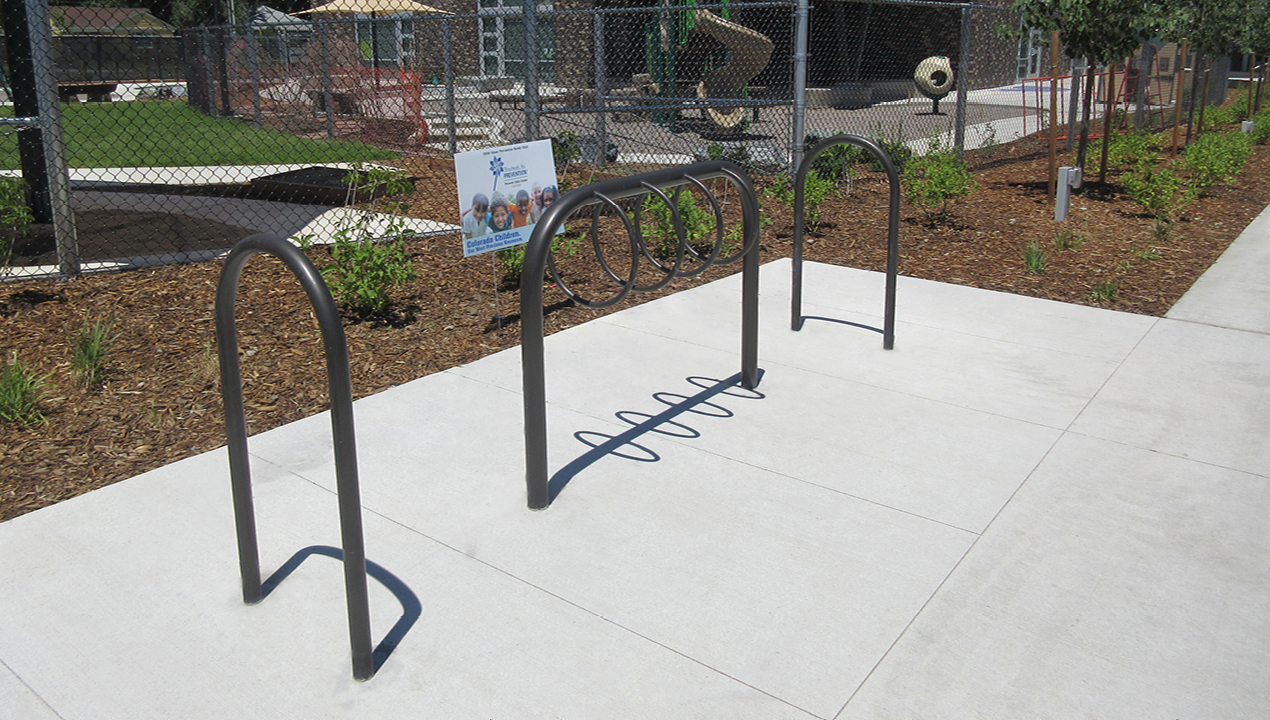 500 Series and 300 Series Bike Racks, direct burial with park in background