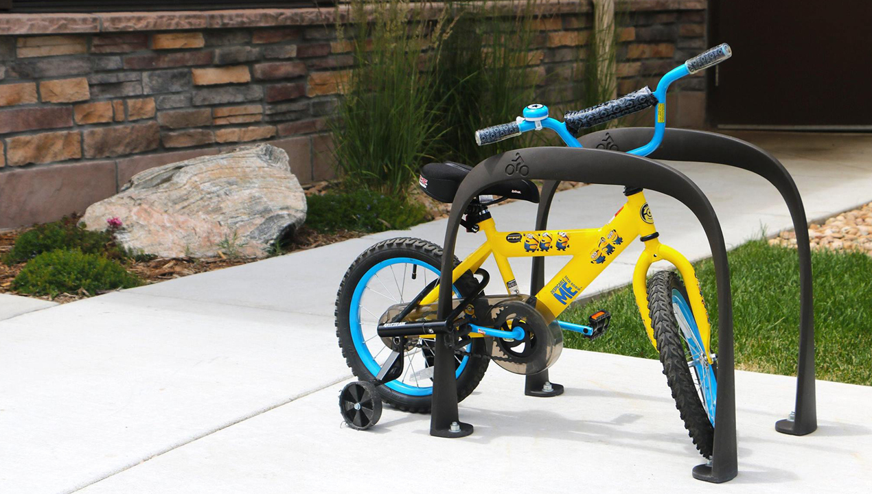 Arch Shaped Bike Rack with small childrens bike