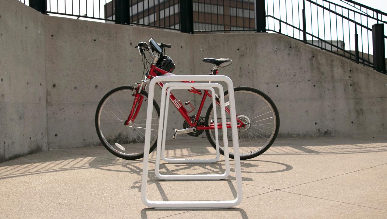 White Bike Rack with Red Bike