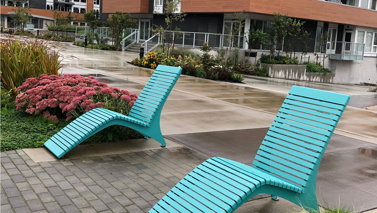 Blue Lounge Chairs Near Building