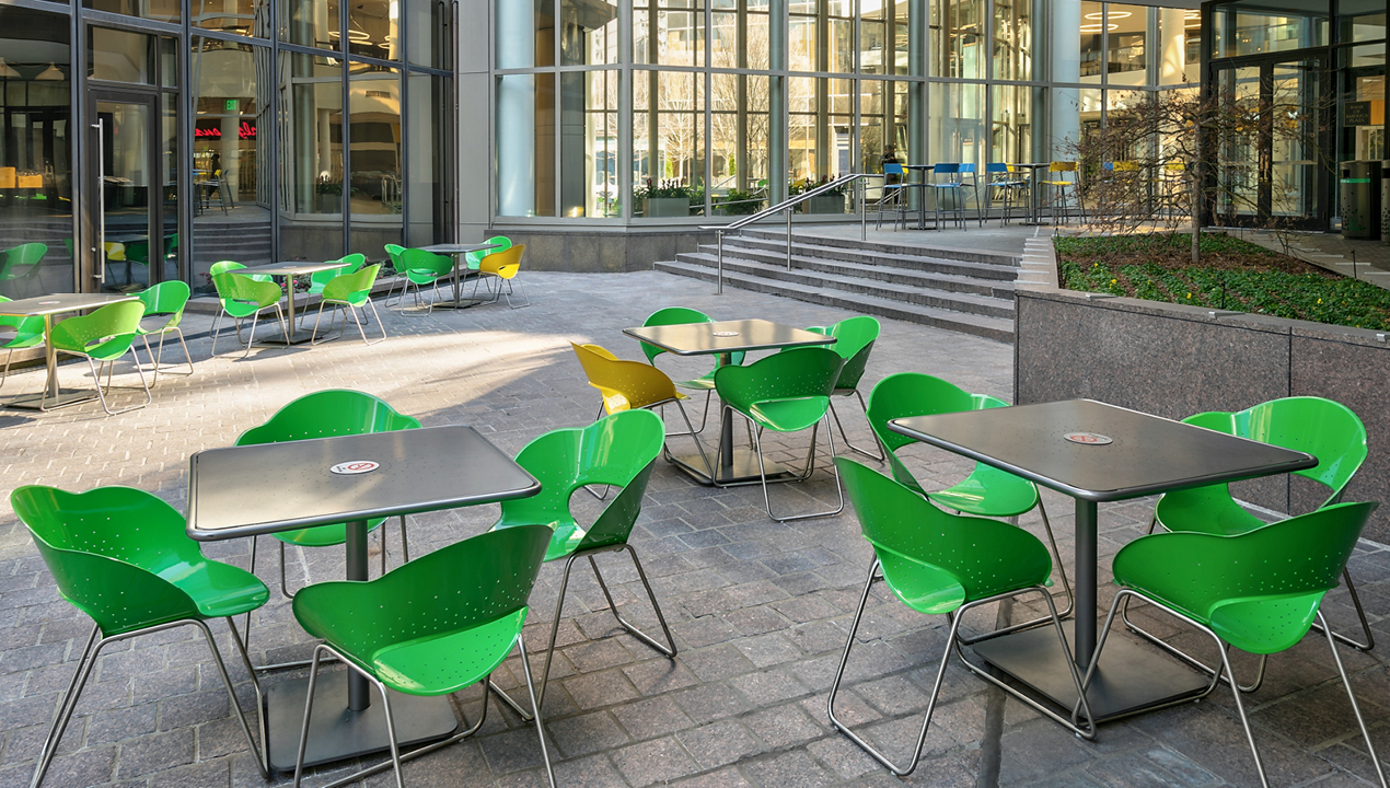 Green and Yellow Battery Chairs outside of Building