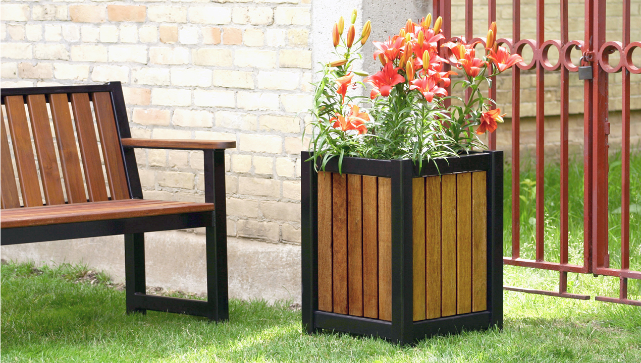 Wood and Black Planter with Orange Flowers