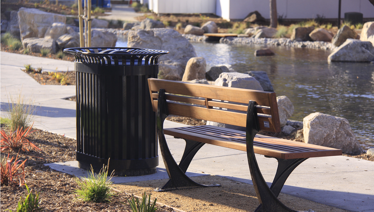 Bench and Trash Can Near River