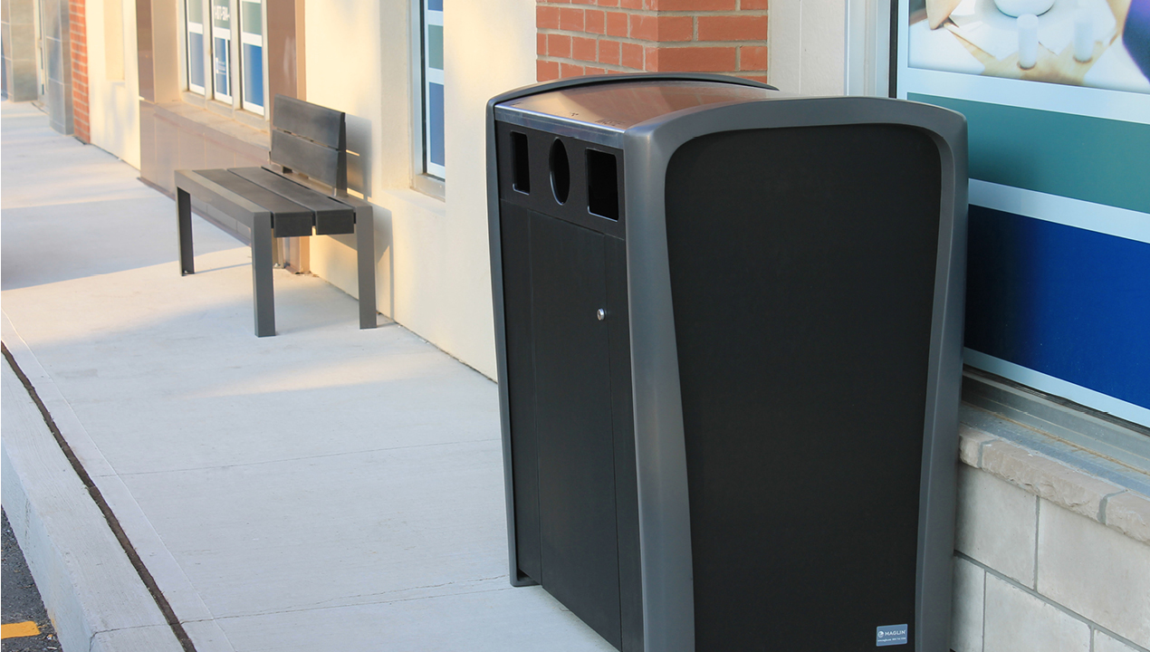 Black and Grey Trash Can Outside Building