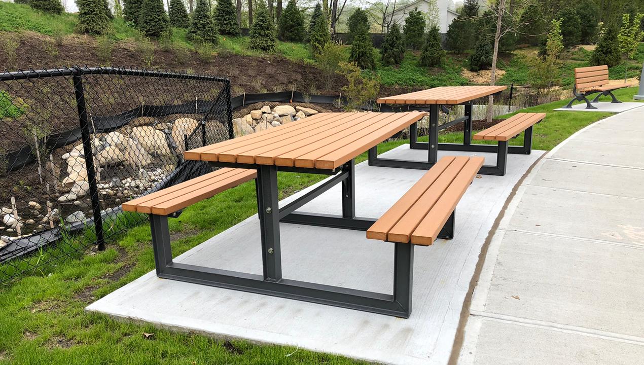 Cedar and Black Metal Picnic Tables near residential area