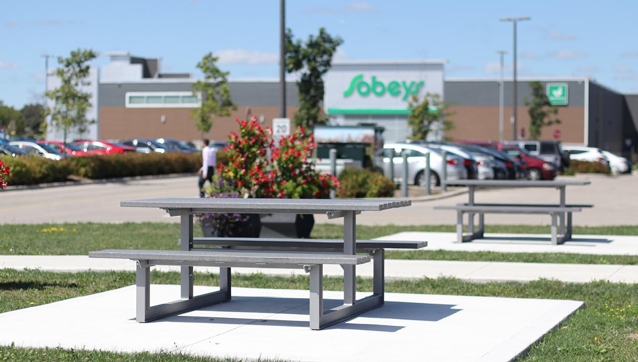 Grey Picnic Table outside Sobeys