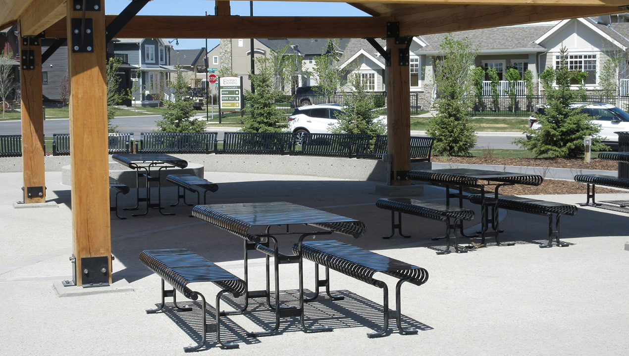 Metal Table with Metal Benches under Pavilion near Subdivision