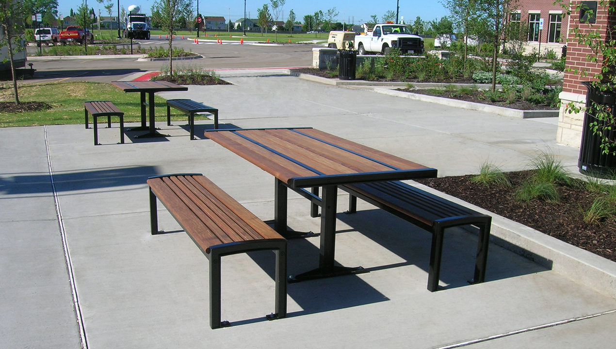 Benches and Table outside Building Near Parking Lot