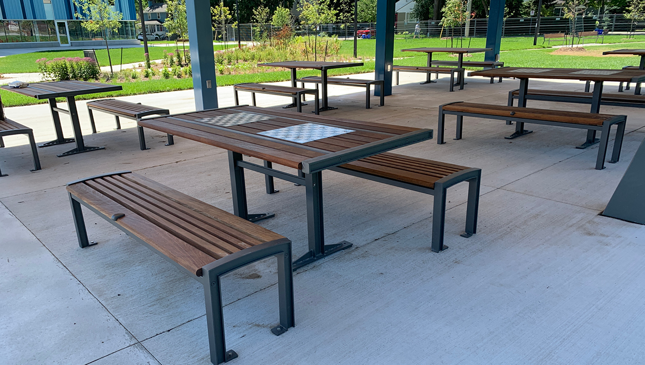 Multiple Table and Benches Under Pavilion Outside