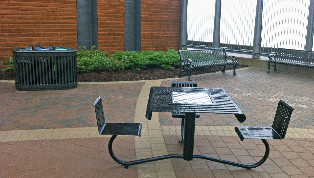 Black WheelChair Accessible Table with Chess Board inside Building