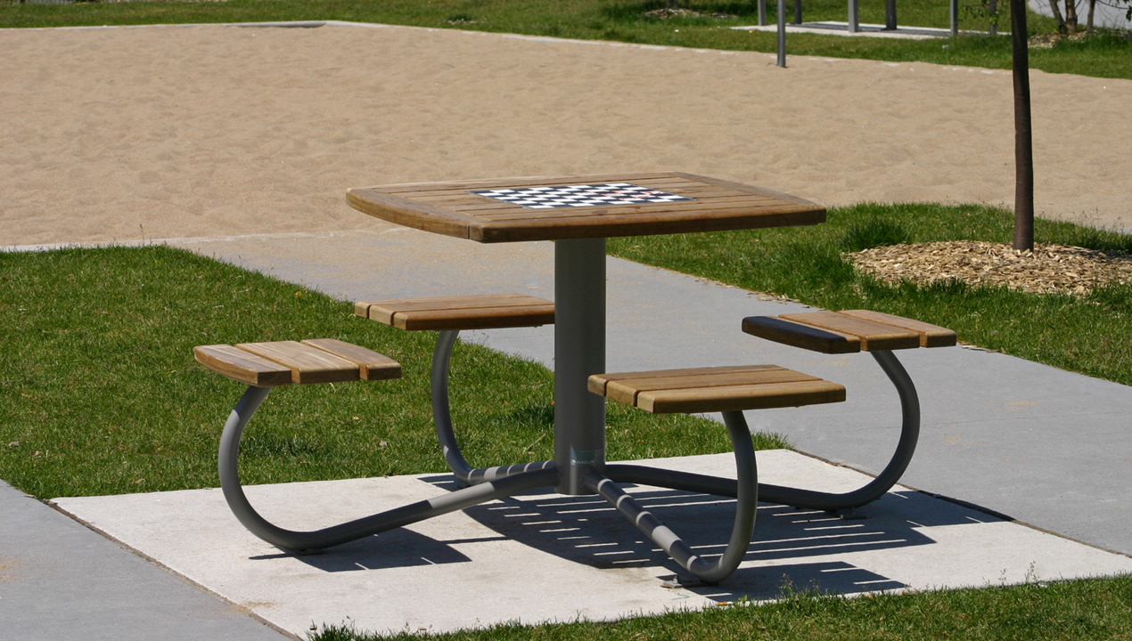 Table with Attached Individual Seating, with a chess board on top at a park