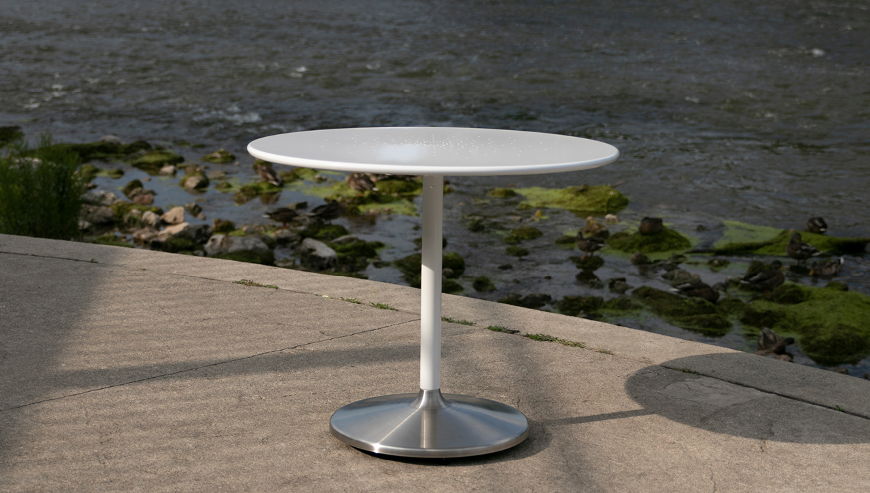 White Circular Cafe Table Near River