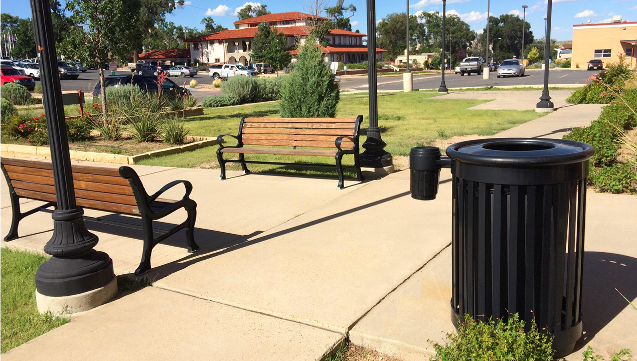 Black Trash Can and Wood Benches in Outside area