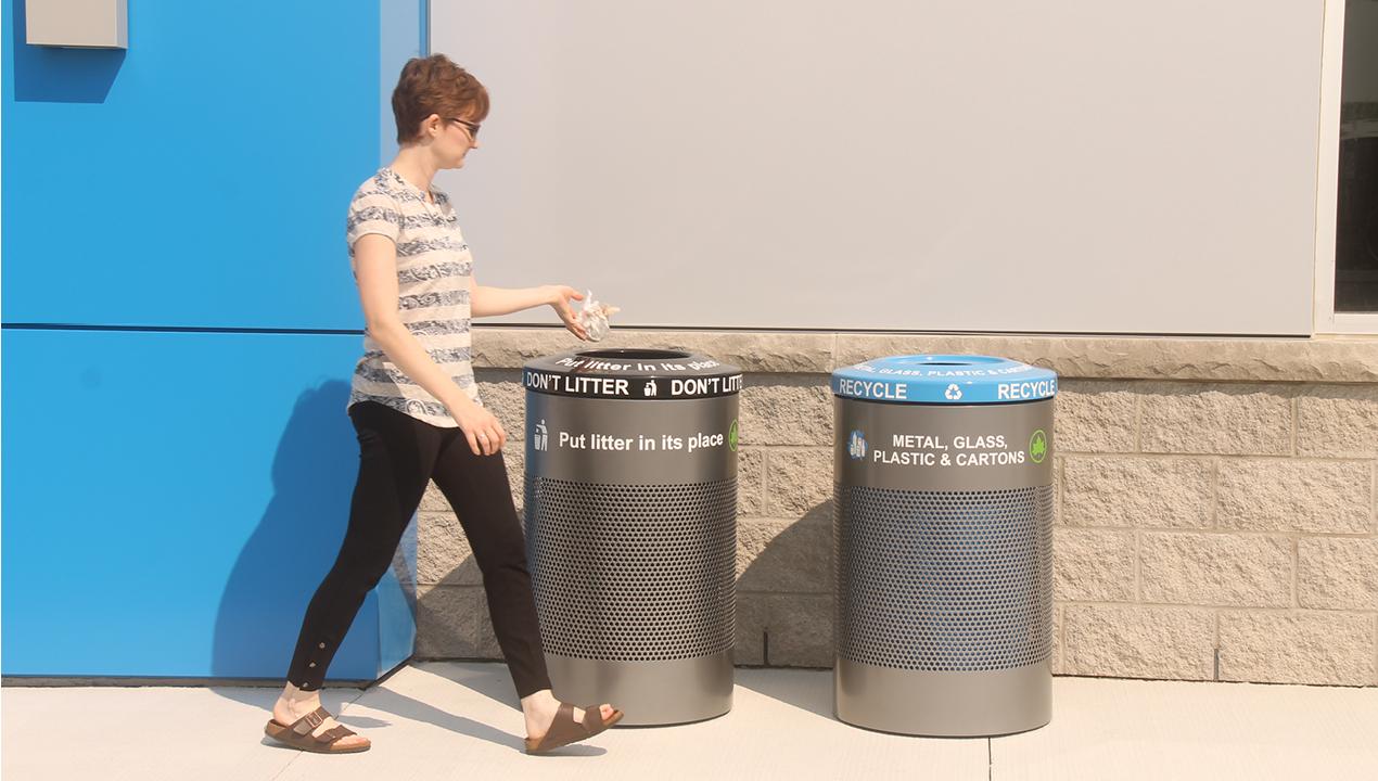 Woman throwing out trash in proper bin
