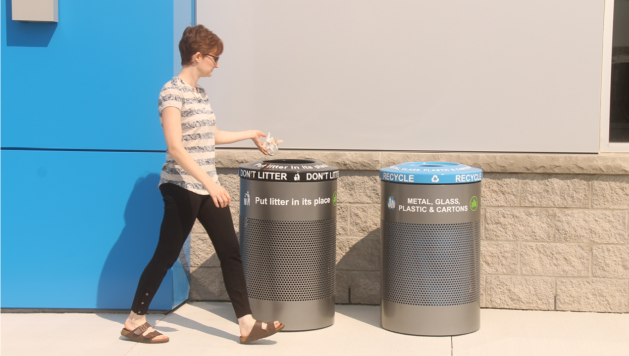 Woman throwing out trash in proper bin