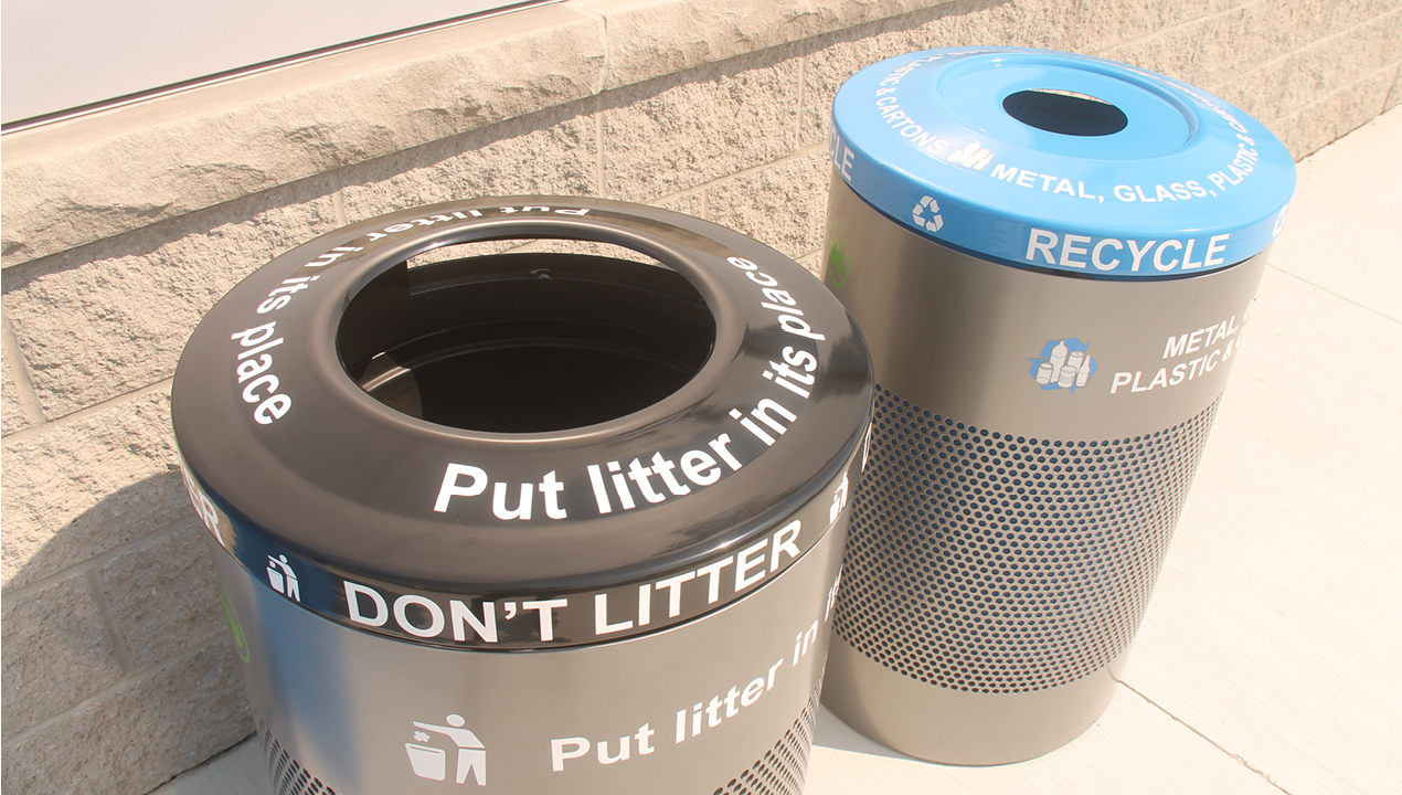Garbage and Recycling bins with a black and blue top