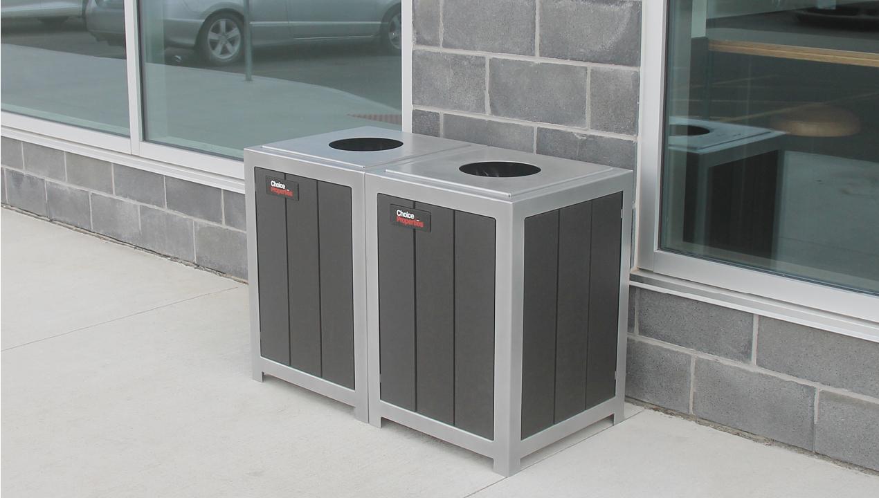 Small Trash Bins Outside Grey Building