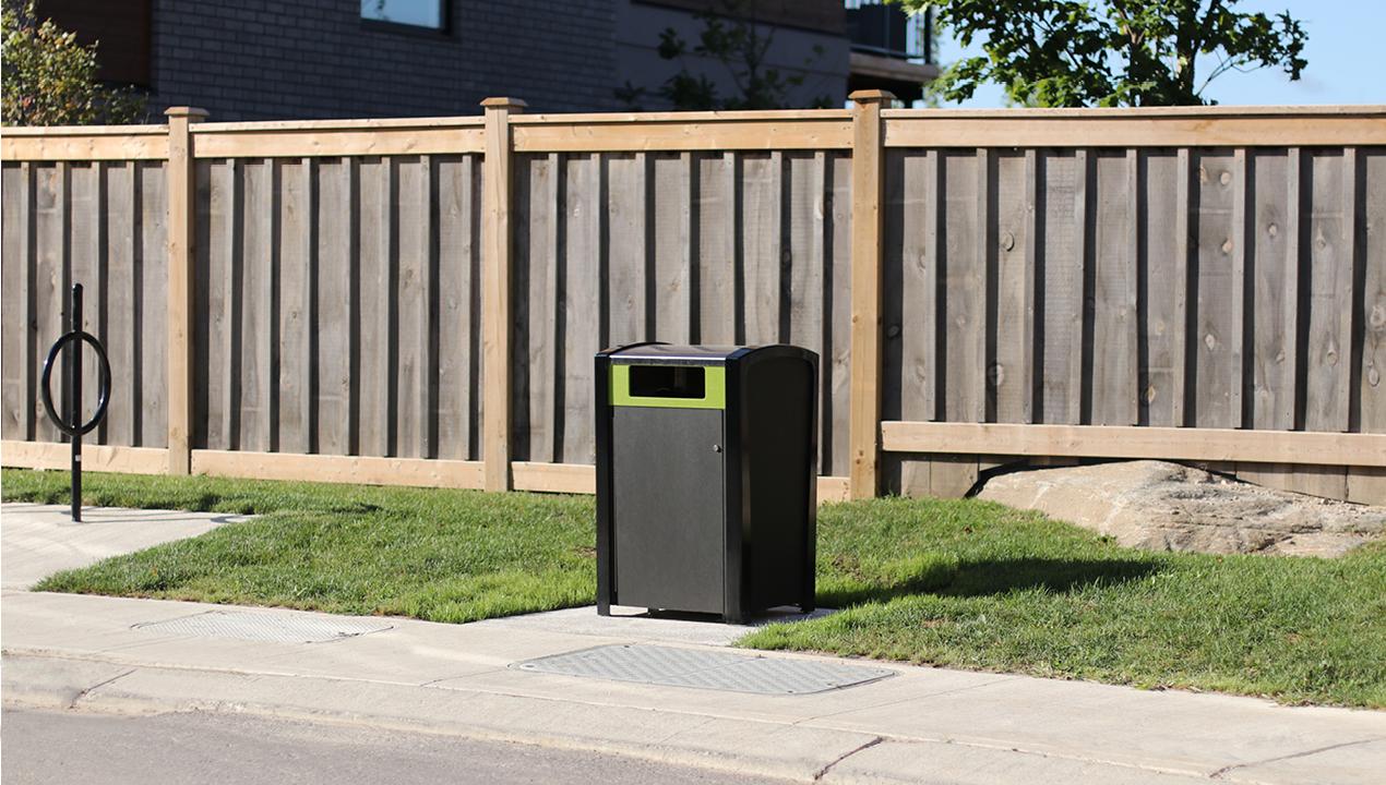 Trash Can Near Wood Fence