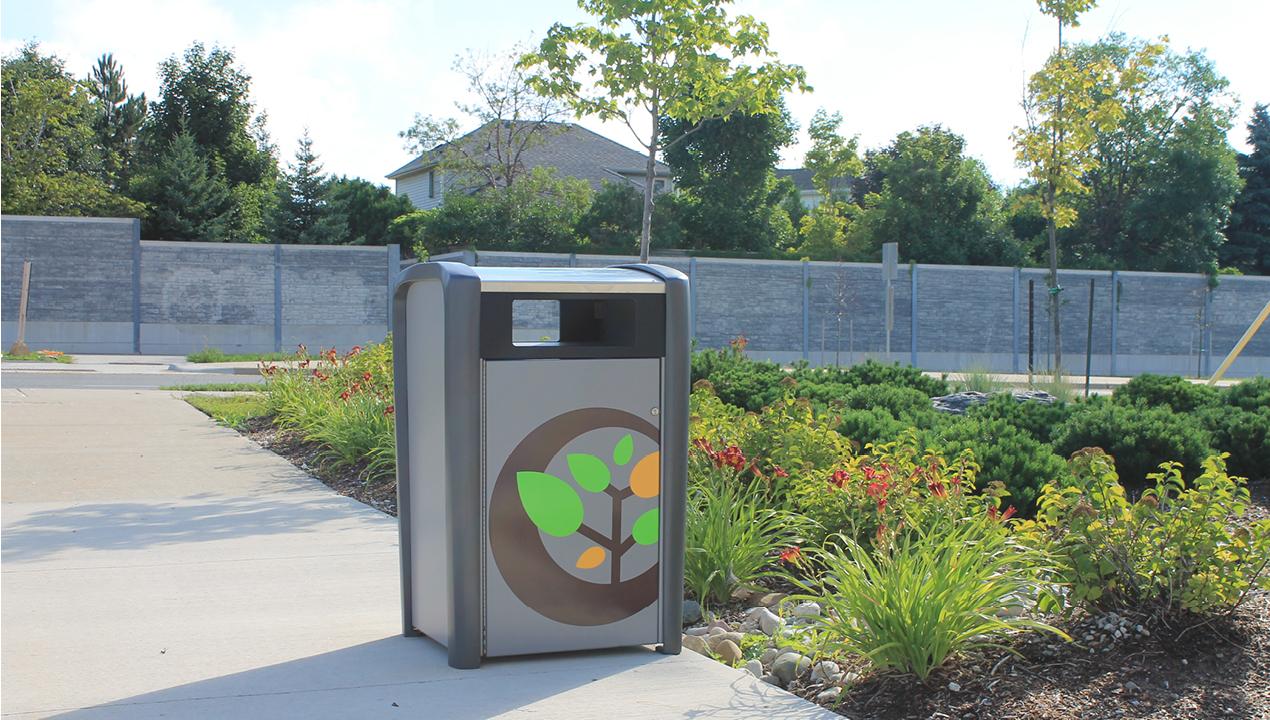 Trash Can outside near Garden
