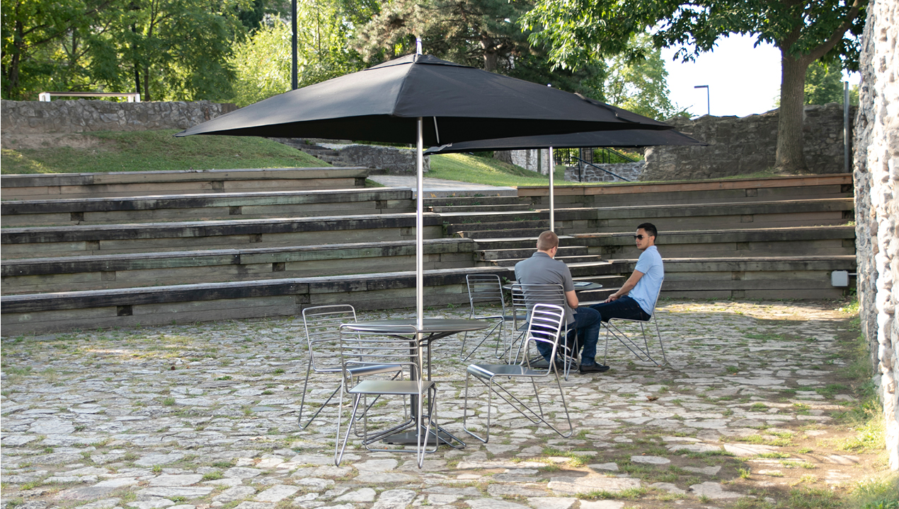 Umbrella, table and chairs outside