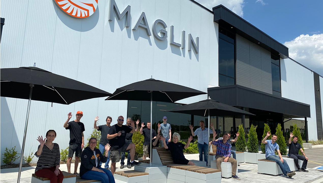 Employees sitting on the patio at Maglin Site Furniture